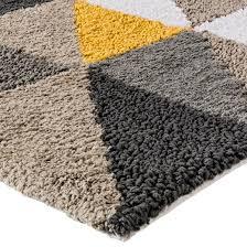 triangle bath rug yellow 20x34