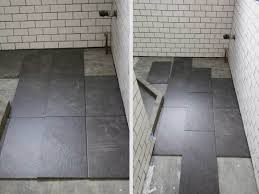 subway tile grey grout bathroom with walk in shower clawfoot tub