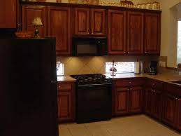 what color cabinets go with black appliances black appliances with oak cabinets do you like the ss or black