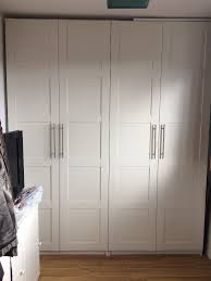 ikea white pax wardrobes with bergsbo doors in standish