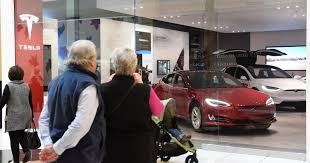 tesla dealership payne first tesla michigan gallery opens at somerset mall