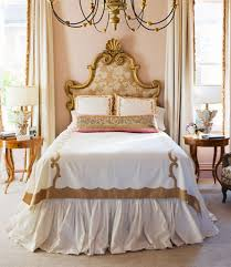 gold framed chandelier and curvy headboard for classic bedroom