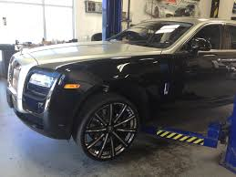 rolls royce gold rims one of the tires from the rolls royce ghost justrolledintotheshop