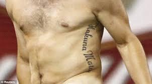 collin grundstrom streaker with hakuna matata tattoo halts