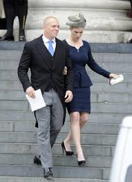 zara phillips is in a grey trench and fascinator at
