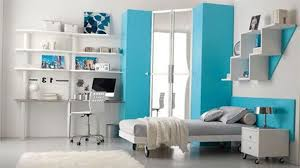 bedroom blue closet organizer with floating bookshelves and study
