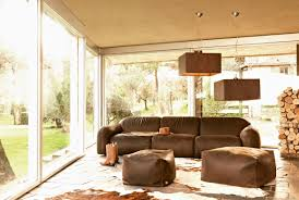 Cowhide Area Rugs Stylish Living Room Design Featuring Bookshelves And Tv Stand With