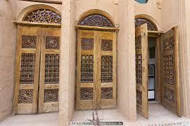 ornamental doors photo khan e lari house yazd iran