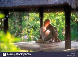 woman reading in thatched bungalow on gili trawangan island lombok