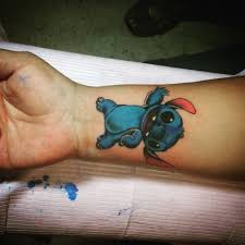 amazing stitch tattoo on wrist