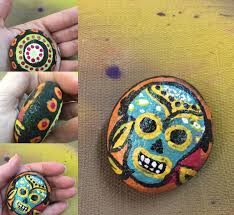 small sugar skull rock painting is