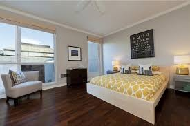 Wood Floor Decorating Ideas Bedroom Design Ideas With Hardwood Flooring Bedrooms Flooring