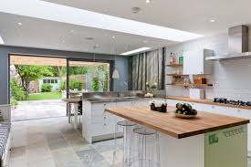 love this use of ceasarstone and incorporating the dining table