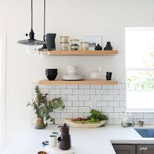industrial kitchen with stainless steel shelves natural wood