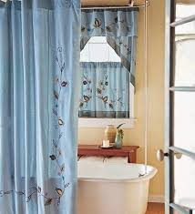 blue fabric double swag shower curtain with matching window shower