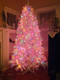 our white tree with colored lights before the ornaments