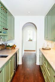 shaker style kitchen pantry cabinet green shaker pantry cabinets with chrome hardware
