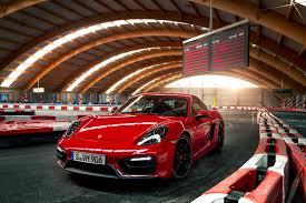 porsche cayman red stunning red porsche cayman gts on a go kart track gtspirit
