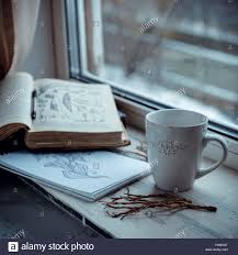 cozy winter still cup of coffee and opened book on