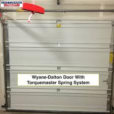 garage door winding rods should i get a torsion spring system or torquemaster springs system