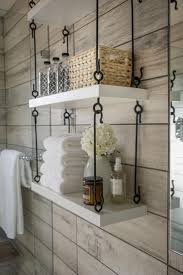 bathroom wall shelf wicker basket white towels wooden wall