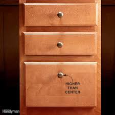 how to install cabinet hardware family handyman install hardware higher on the lowest drawer