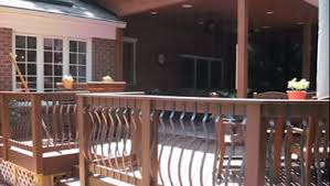 trex transcends composite deck and rail under covered porch and