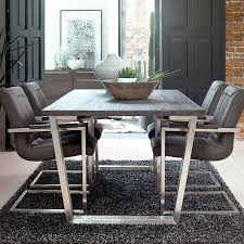 acacia dining table and 6 armchairs