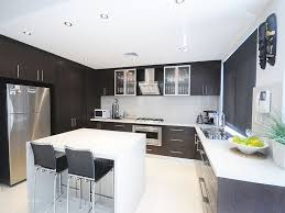 modern u shape kitchen with cabinet and white island with