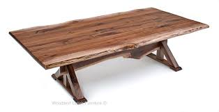 solid wood trestle dining table this striking live edge dining table is a new design by the artisans