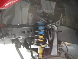 nissan armada air shocks removing coil spring question nissan titan forum