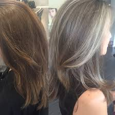 blonde streaks for greying hair transitioning from colored hair to silver grey hair saltandpepper