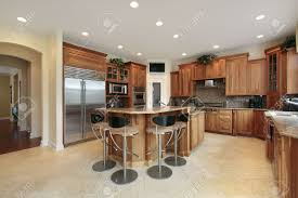 kitchen in luxury home with bar stools stock photo picture and