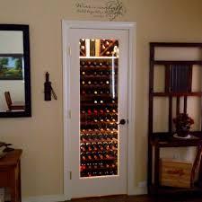 my entryway closet wine cellar replace door with glass door and