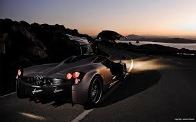 pagani huayra wallpaper red pagani huayra sports car rear view wallpaper 28625