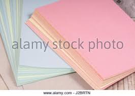 yellow blue pink pages notebook white stock photo