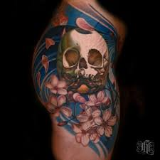 coloured skull and cherry blossoms on shoulder
