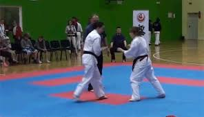 imagenes gif karate young woman lands rolling karate head kick knockout the big lead
