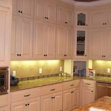 pleasant distressed white cabinets painted with chrome microwave
