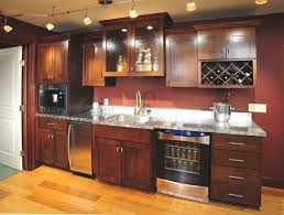 track lighting near brown maple wood storage cabinets use floating