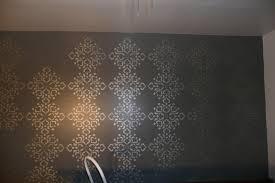 remodelaholic stenciled wall master bedroom