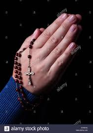 a rosary praying holding a rosary with jesus in the