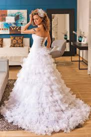 white strapless tiered ruffled tulle ball gown wedding dress side