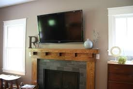 interior wood fireplace mantels with tv above design fireplace