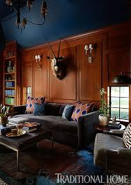 the den at dining in an overscale sofa in steel blue mohair in the den plays against the