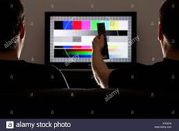 test pattern media two men watching a test pattern on a television stock photo