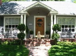 small porch with potted plants and wreath ways to decorate a
