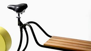 a bench with a pedal powered streetlight built in co design
