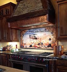 travertine subway tile kitchen backsplash with a mosaic glass tile