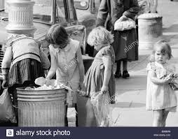 Seeking Dublin Children Seeking Food In A Refuse Bin In Dublin Stock Photo